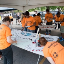 Volunteers paint murals for the Bagley Gardens pocket park.
