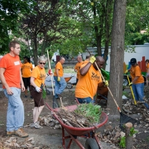 Austin Moir (left), with Southwest Solutions Neighborhood Preservation Team, helped coordinate the volunteer projects.