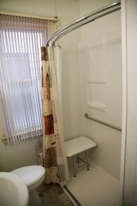 Metro In-Home Solutions installed a walk-in shower and handrails in the bathroom of Mattie Heard's home.